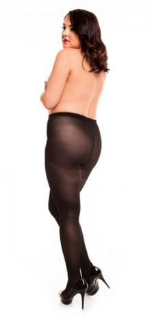 Plus size model wearing Glamory vital 40 support tights in color black back view