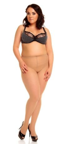 Plus size model wearing Glamory vital 40 support tights in color teint front view